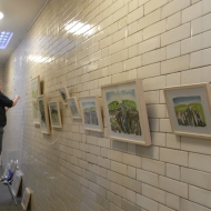 Julia, hanging the exhibition