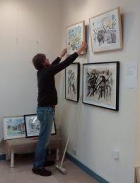 David hanging the pics at Bono Art Gallery 2014