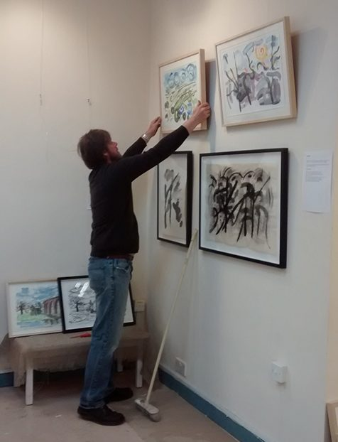 David hanging the pics at Bono Art Gallery 2014